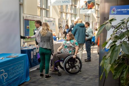 Attendees from Rare Disease Day at NIH 2020 converse in the exhibit area.