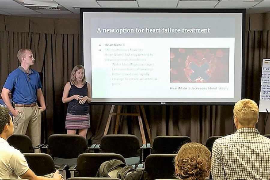 Scott Graupensperger and Bethany Latten give a presentation during last year's Summer Translational Science Fellowship, a highly interactive program for both medical and graduate students to receive a foundation in research skills. (Photo: Penn State)