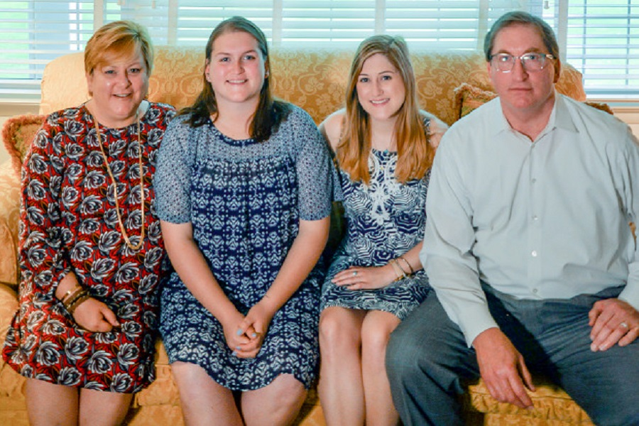 Mary Thomson-Martin, Kelsey Martin, Emily Martin and Eric Martin at their home in Clifton, Virginia. (Photo by Leha Byrd, University Public Affairs)