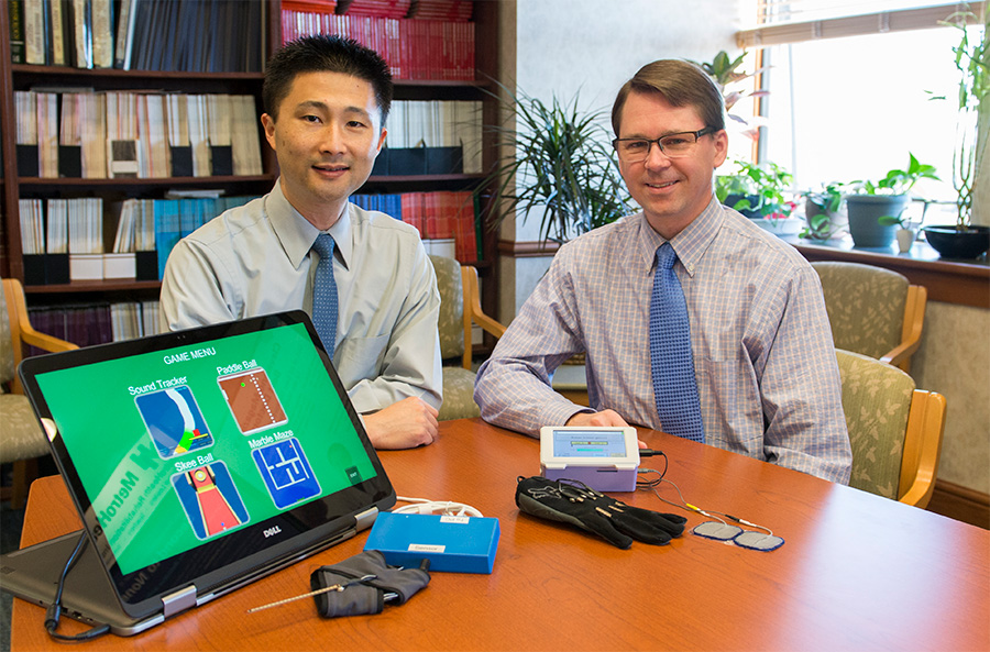 Michael Fu and Jayme Knutson with their Contralaterally Controlled Functional Electrical Stimulation video game therapy