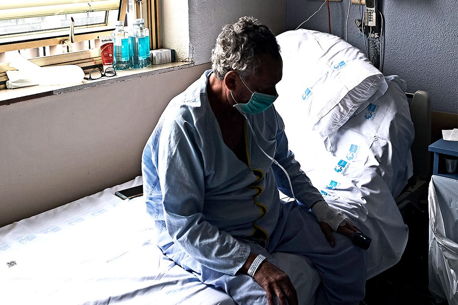 A COVID-19 patient rests in his room at the Gregorio Marañón Hospital on April 07, 2020 in Madrid, Spain. (Credit: Carlos Alvarez/Getty Images)