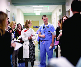 Doctors walking through a hospital on rounds