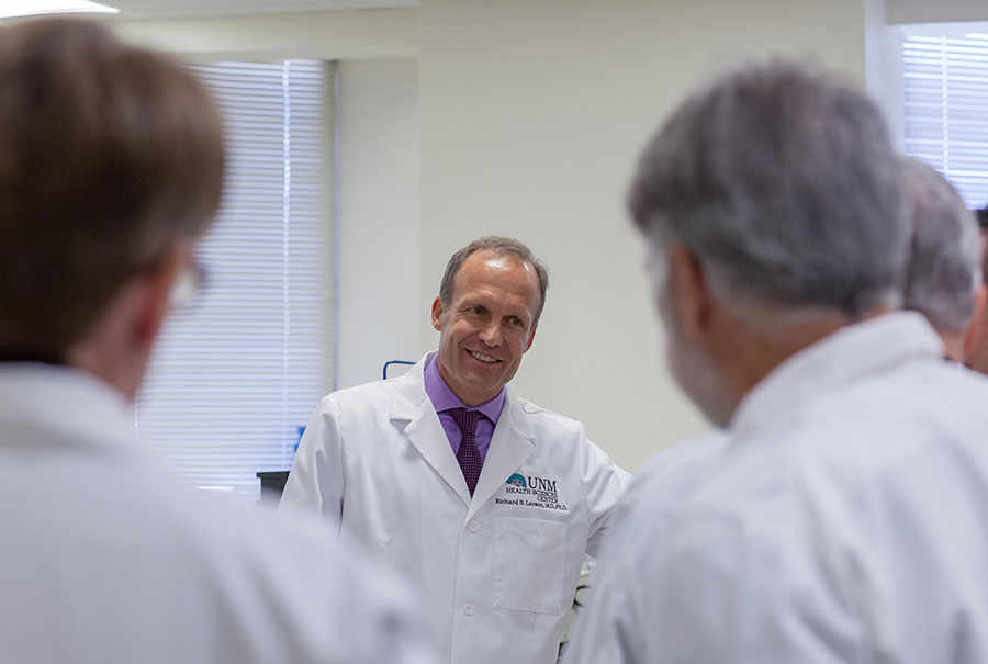 University of New Mexico researcher Richard Larson, M.D., Ph.D., with some of his colleagues.