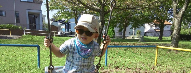 A young boy with WAGR syndrome on a swing.