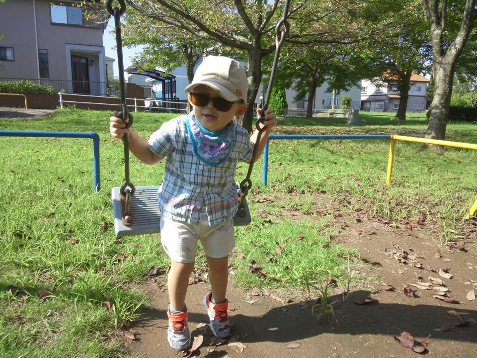 GRDR boy playing on swing
