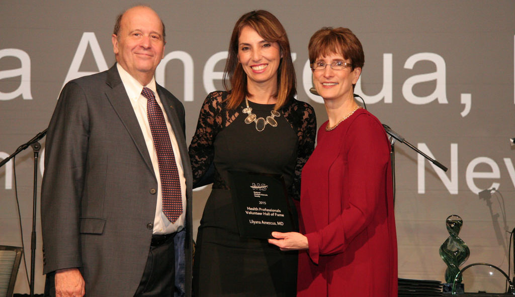 Lilyana Amezcua, center, receives an award, with Eli Rubenstein and Cynthia Zagieboylo.