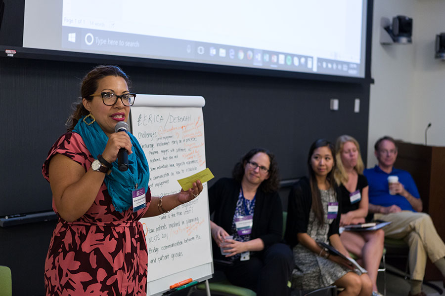A participant shares her group's top two ideas from the brainstorming breakout session at NCATS Day: Partnering with Patients for Smarter Science on June 30, 2017.