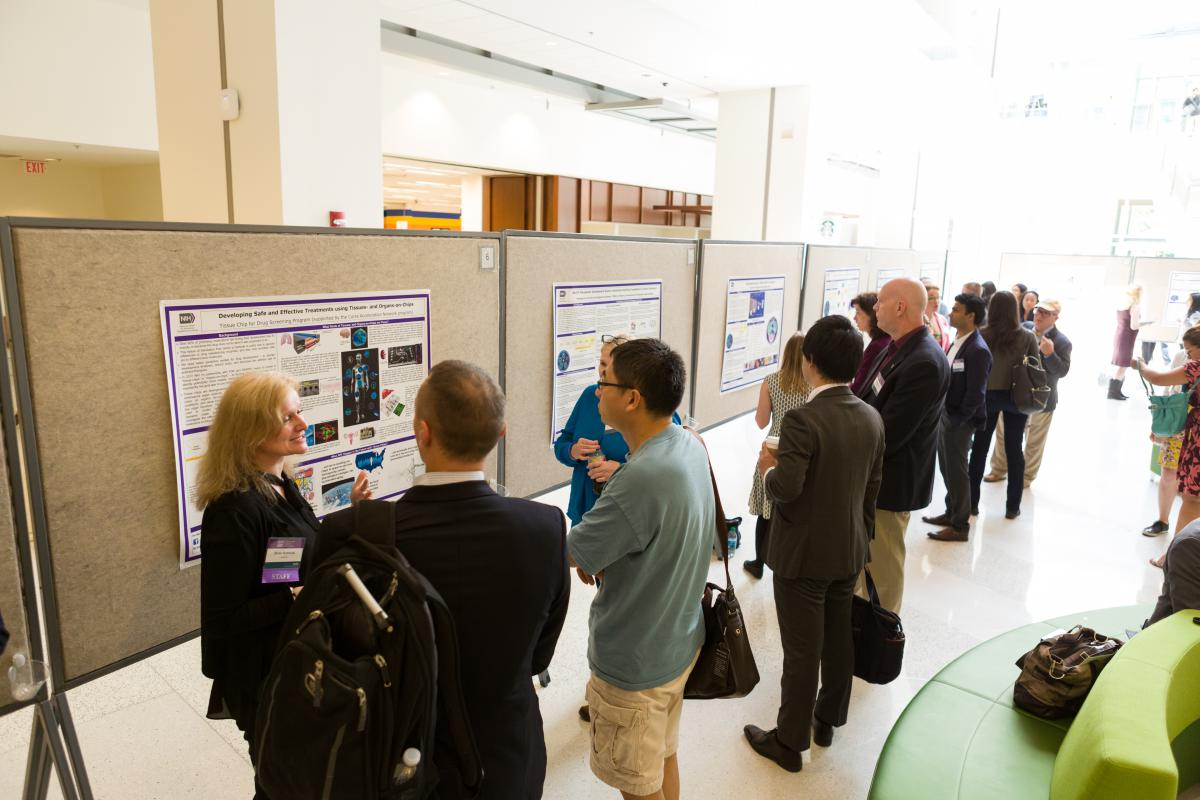 Participants at NCATS Day: Partnering with Patients for Smarter Science on June 30, 2017 view posters about NCATS programs and initiatives. Credit: Daniel Soñé Photography