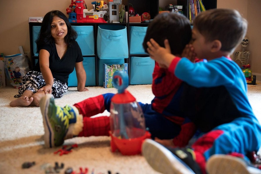 Nina Nizar and her sons in there Elkhorn-area home in March 2017. Photo: Megan Farmer/The World Herald