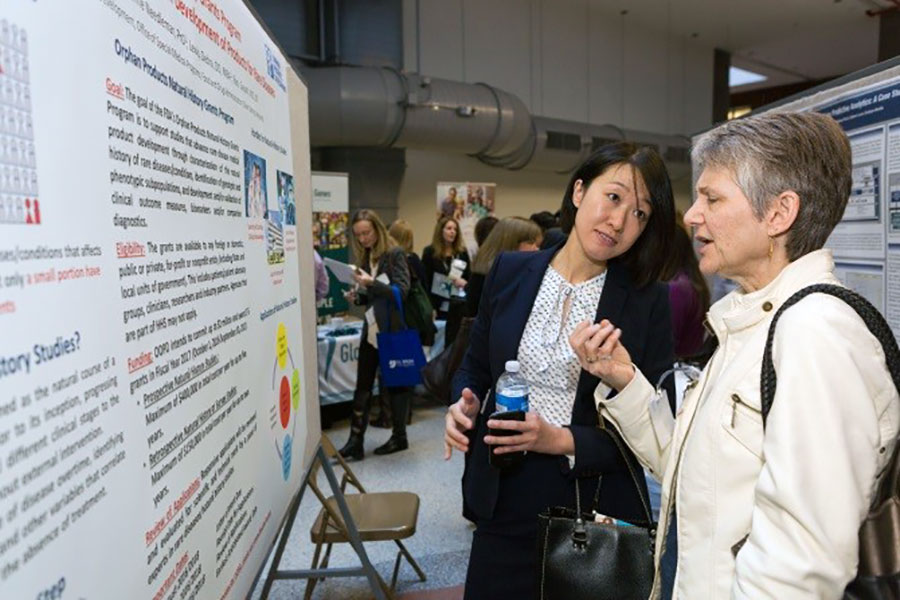 Poster presenters discuss research at 2016 Rare Disease Day at NIH