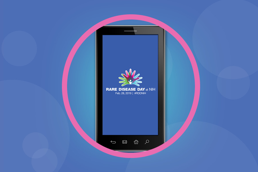 Smartphone with Rare Disease Day at NIH logo displayed on the screen