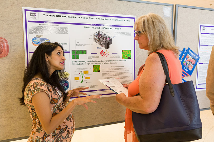 Sue Hargrave of Itching to Help!, LLC, discussed a poster with Madhu A. Lal-Nag, Ph.D