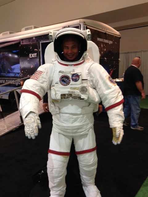 NCATS' Dr. Danilo Tagle in a space suit.