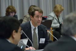 Christopher Austin, M.D., speaking at a Council meeting.